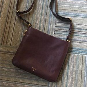 Oxblood leather crossbody by Fossil.